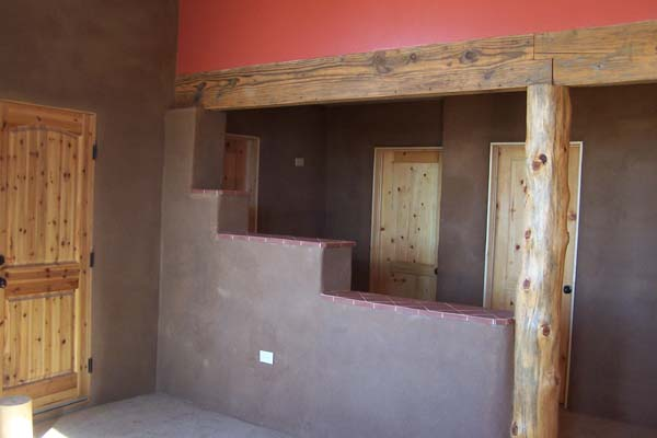 earthen plaster in entry hallway