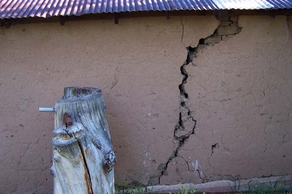 large crack in the adobe wall