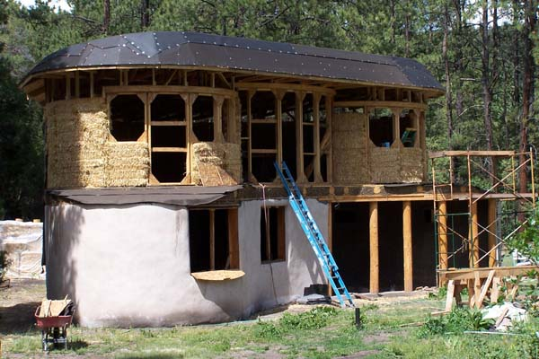 2 story curved straw bale walls