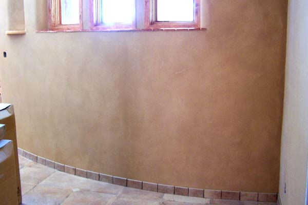 curved adobe wall
