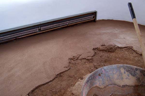 Laying new adobe floor earthen touch natural builders for Adobe floor