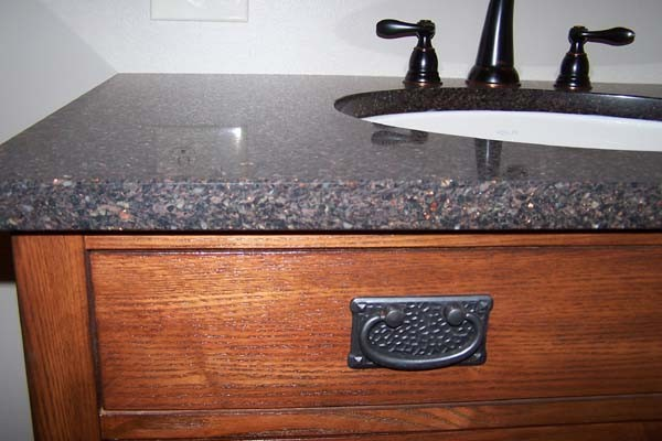copper flecked granite counter on vanity