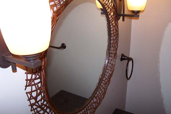 copper frame on round mirror