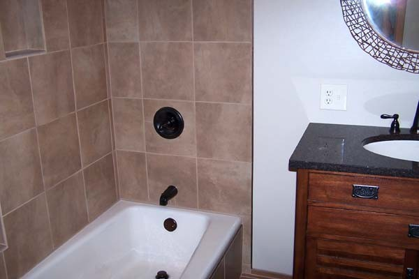 Tiles used are shades of brown with copper accents
