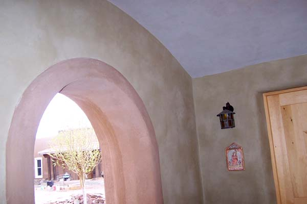 green plaster white arched ceiling