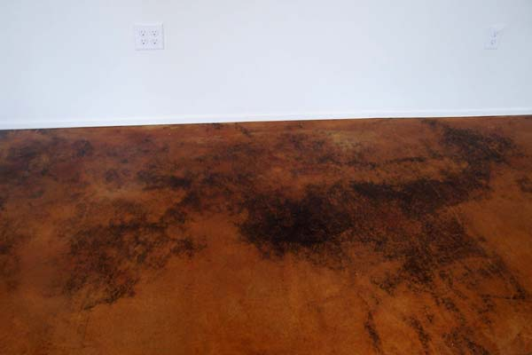 acid stained cement floor deep copper tones