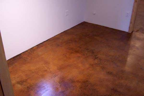 copper colored acid stained cement floor