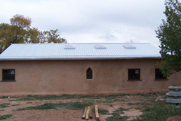 Rastra block building with completed metal roof