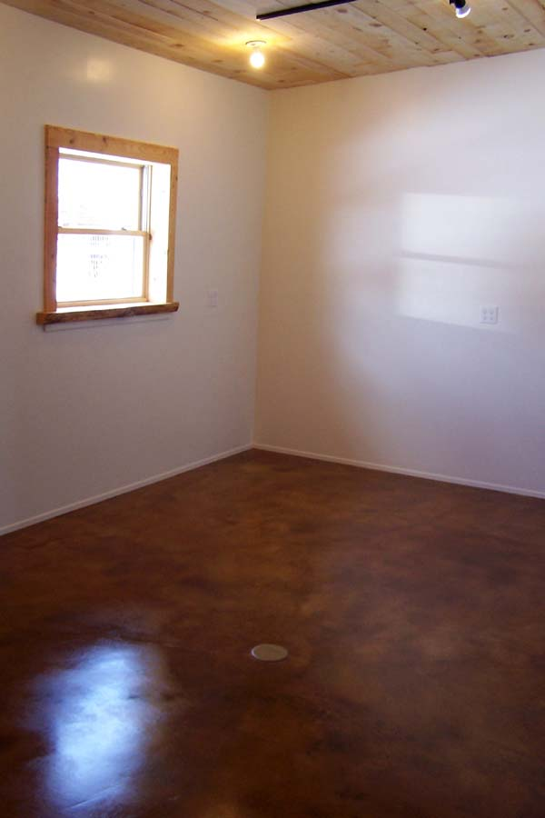 copper colored acid stain with white walls