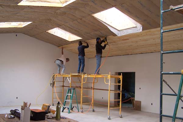 rough sawn pine ceiling being applied