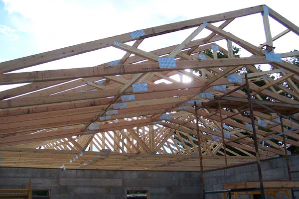 rastra block roof trusses being raised