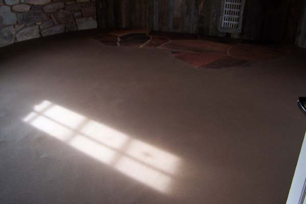earthen floor with flagstone inlay