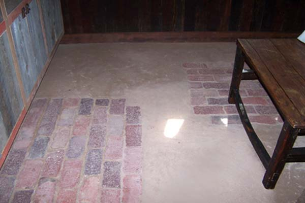 inlaid raw brick in earthen floor