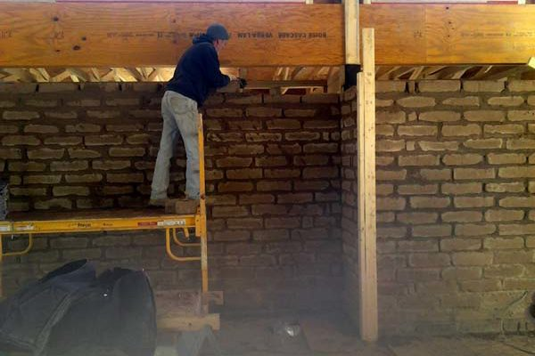 adobe walls going up
