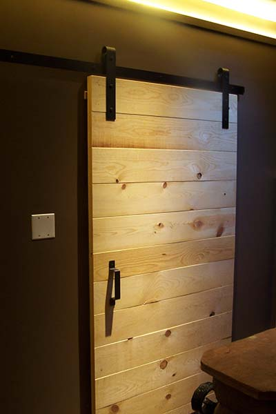 Simple Pine Barn Door With Black Hardware